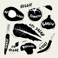 collection of ink vegetables silhouette illustrations with handwritten lettering on each vegetable with its name.