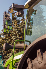 A cab of a modern tractor against the blue sky. Mechanization of agriculture.