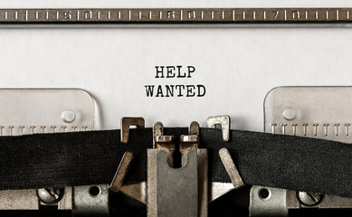 Text Help Wanted typed on retro typewriter