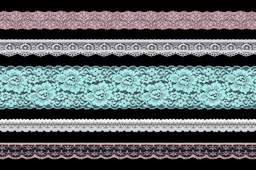 Set of multi-colored lace ribbons on a black background. Lace braid.