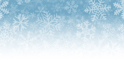 Christmas illustration of many layers of snowflakes of different shapes, sizes and transparency. On gradient background from light blue to white.