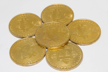 Golden bitcoin on white background