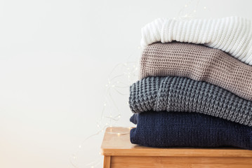 Wall Mural - Stack of cozy winter sweaters