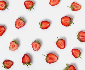 Halves of strawberries on the white background.