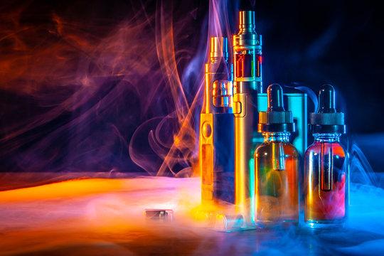 VAPE Electronic Cigarette. Liquid for VAPE. Steam from an electronic cigarette. VAPE concept
