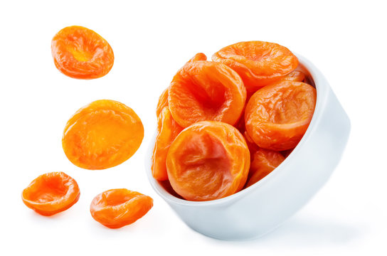 Dried Apricots fruits in a bowl isolated