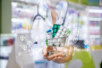 Shopping cart with drugs in the hands of a physician .
