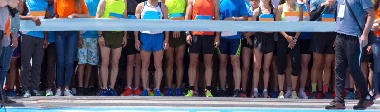 start line in road marathon competition feet background