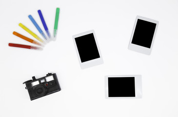 Instant Photos with a mini camera and colored markers on isolated white background Wall mural