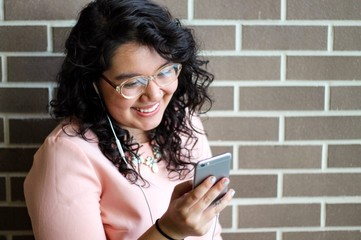 Woman smiling at smartphone