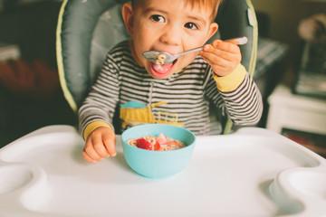 Toddler eating cereal