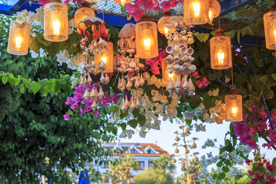 Lantern with light under bougainvillea flowers in Datca, Turkey during summer