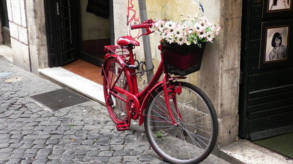 Red bicycle in a district of Roma - Italy