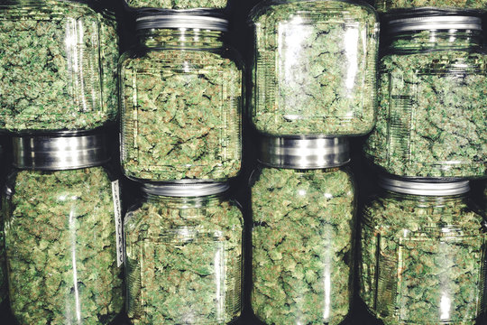 Marijuana Buds in Glass Jar Stack