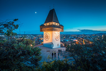 City of Graz with famous clock tower at night, Styria, Austria