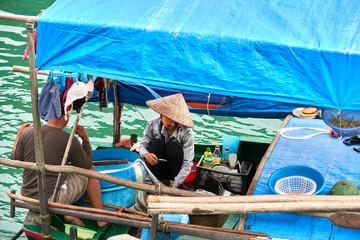 Ha Long Bay , Vietnam-29 November 2014:Floating vendor selling various to tourists visiting Ha Long Bay, UNESCO World Heritage Site