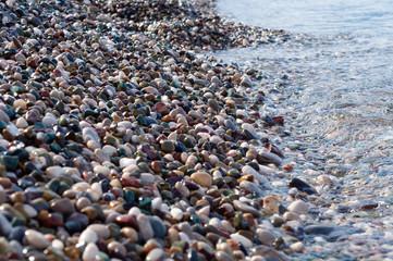 Sea pebbles on the shoreline, close-up