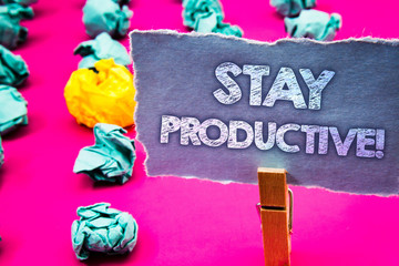 Writing note showing  Stay Productive Motivational Call. Business photo showcasing Efficiency Concentration Productivity Words torn paper wooden clip pink background crumbled yellow blue note.
