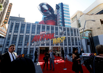 "People take a selfie at the premiere of the movie ""Ant-Man and the Wasp"" in Los Angeles"