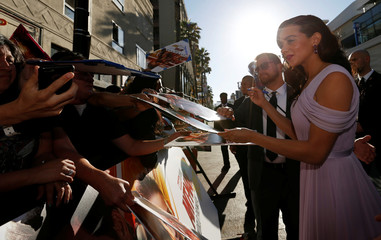 "Hannah John-Kamen signs autographs at the premiere of the movie ""Ant-Man and the Wasp"" in Los Angeles"