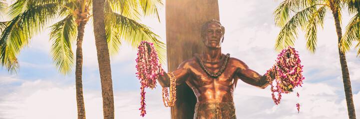 Panoramic banner of Duke Kahanamoku statue on Kuhio Beach Park in Waikiki, Honolulu, Oahu, Hawaii travel vacation tourist destination. Panorama header crop. Wall mural