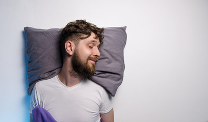 Man sleeping on side with smile, good sleep