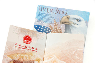 open passports of China and USA isolated on white background