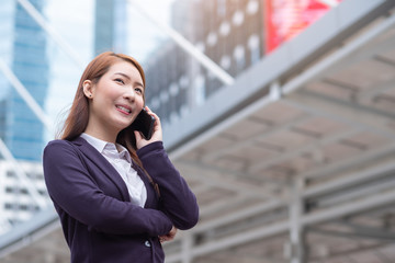 Portrait of young beautiful business woman in modern city. Business person