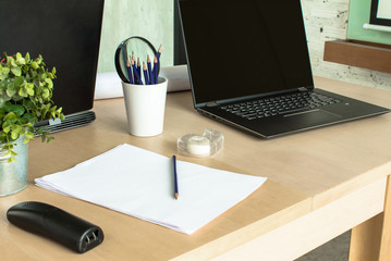 Empty home office desk with space for working.  Clean and comfortable workspace for entrepreneur.