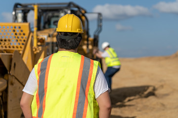 supervisor watching climbing on excavator equipment