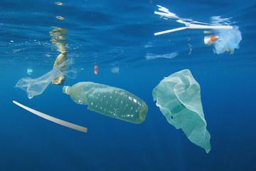 Plastic ocean pollution. Underwater bags, bottles, cups, straws