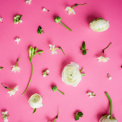 Flowers and buds on pink background. Flat lay, top view. Floral pattern