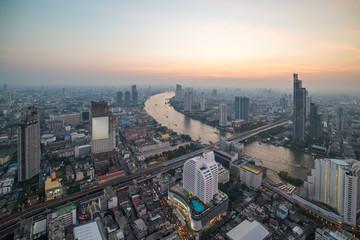 Aerial view of Bangkok cityscape and Chao Praya river