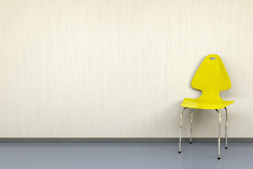 yellow chair at a wall with space for your content