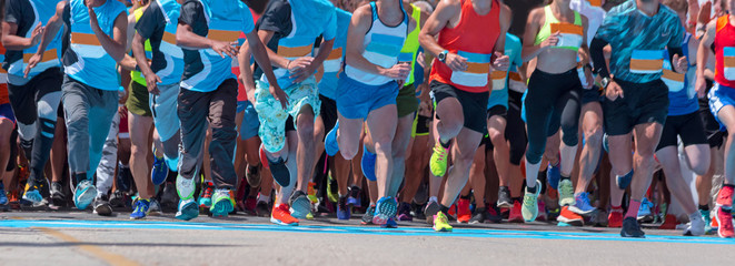 start line runners in road marathon competition feet background
