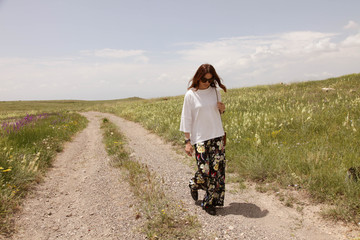 Woman in the nature field and flowers