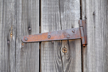old wooden door with a rusty loop