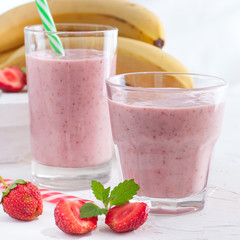Strawberry and banana smoothie in the jar,square