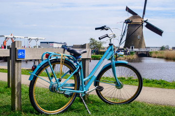 One bicycle baked in Kinderdijk village in The Nertherlands. Sun