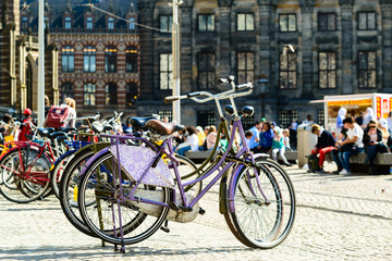 Bicycles parked on the city street in Amsterdam, The Netherlands