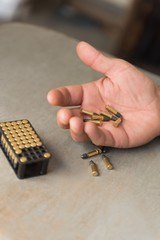 Man holding bullets in hand