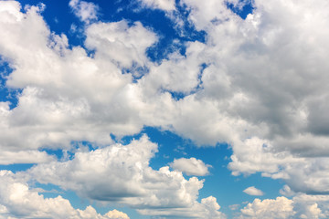 White clouds on the blue sky. Background.