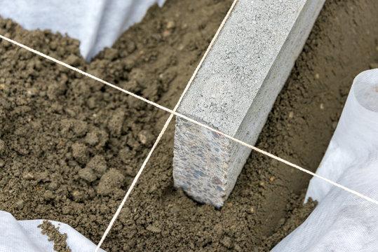 Setting edge restraints with border stones in concrete