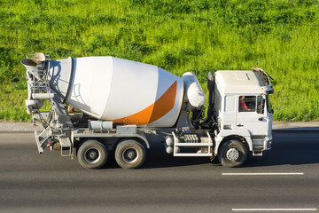 Concrete Mixer Truck rides the road highway.