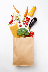 Image of paper bag with vegetables and spaghetti