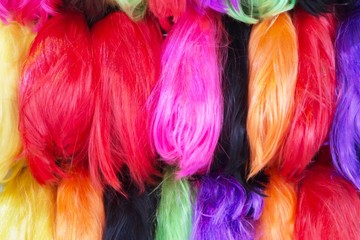 Close up Wig hairpiece colorful variety in wigs shop store. or sample Hair color dyes hair salon.
