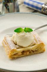 Apple pie and vanilla ice cream. Apfelstrudel. Tart apples with raisins and vanilla ice cream