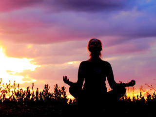 Yoga practicing emotional concept art. Silhouette on vintage tone sunset light. Surreal Twilight colorful, vintage filter effect. Pastel tone, colors. Good looking background. Copy space. .