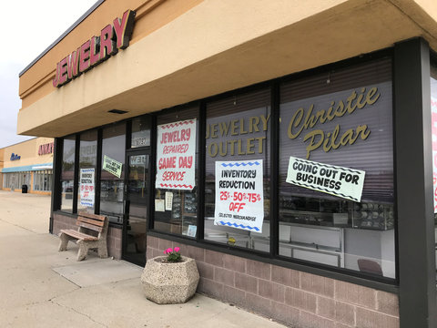 "One of the shops displays ""Going out of business"" sign at the Landings strip mall in the suburbs of Chicago"