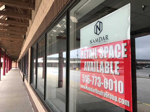 A store vacancy sign hangs at a property owned by Mason Asset Management and Namdar Realty Group at Matteson Town Center in Matteson